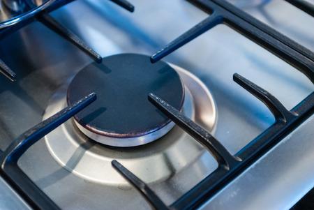 Metallic kitchen stove burner and square frame.