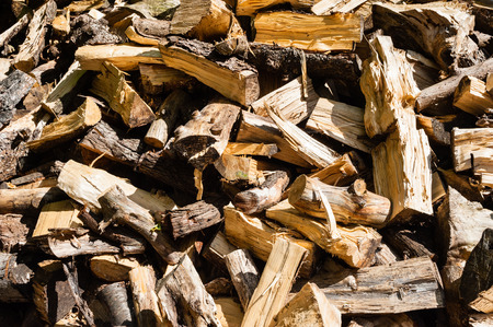 jumbled: Abstract jumbled disorganized pile of chopped and cut firewood. Stock Photo