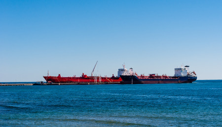 MISSISSAUGA, CANADA - OCTOBER 10, 2016: Two tanker ships are docked at the Suncor Energy lubricants plant on the northern shore of Lake Ontario. Editorial