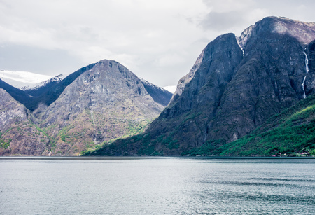 Steep mountains surrounding the Sognefjord in Norway.