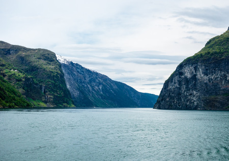 Narrowing cliffs and slopes surrounding the Sognefjord in Norway.