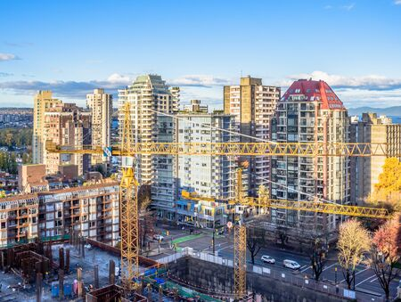 VANCOUVER, CANADA - NOVEMBER 02, 2018: Cranes erect a new building in the dense downtown of the city.