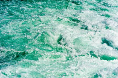 Abstract powerful churning water and rapids in Niagara River, Ontario, Canada.