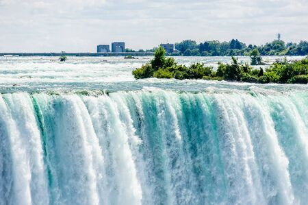 Dangerous rapids falling over edge at top of Horeshoe Falls at Niagara Falls, Ontario, Canada. 写真素材
