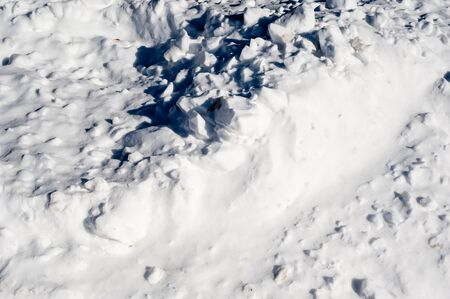Abstract chunks of white snow with shadows.