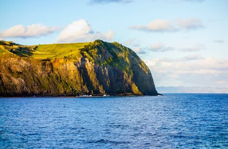 Most eastern point of Faial Island ending in steep cliff at ocean, in Azores, Portugal.