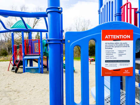 MISSISSAUGA, ONTARIO, CANADA - APRIL 16, 2020: The city closed all park facilities in late March 2020, including this playground in Erindale Park, to prevent the spread of COVID-19.