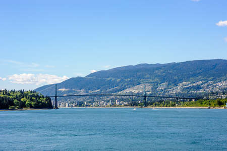 Lions Gate Bridge, which connects Vancouver to the North Shore, against surrounding city and hills.