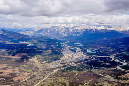Town and surrounding wilderness and mountains in Jasper, Alberta, Canada.