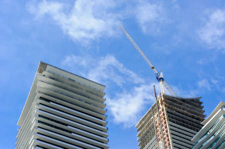 TORONTO, CANADA - MARCH 17, 2019: Construction of modern residential condominium towers nears completion in Etobicoke, in the west end of the city. Редакционное