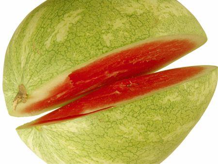 carotenoid: Un trozo abierto (de corte) sand�a aislados en fondo blanco  Foto de archivo