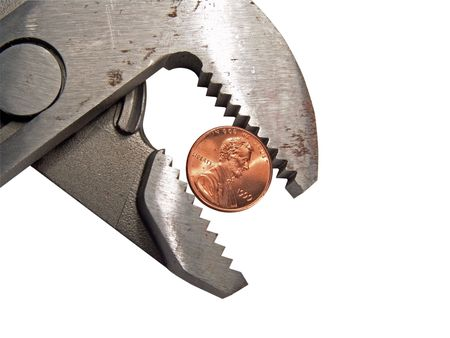 griping: Groove lock pliers griping or squeezing a United States penny Stock Photo