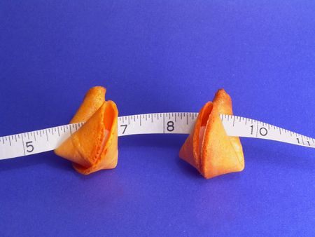 Two fortune cookies and a measuring tape photo