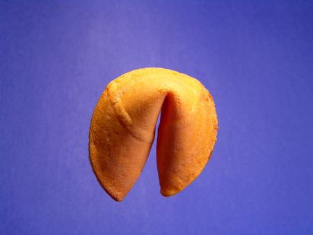 to foresee: A single fortune cookie isolated and suspending in the air Stock Photo