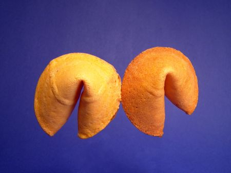 foresee: Two fortune cookies isolated and suspending in the air