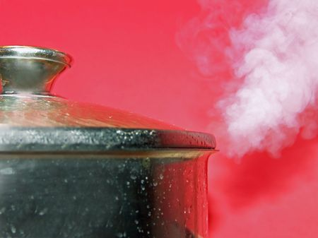 Hot steam coming out from a cooking pot Stock Photo