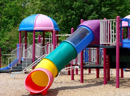 Children's playground with beautiful slides and exercise setting                                photo
