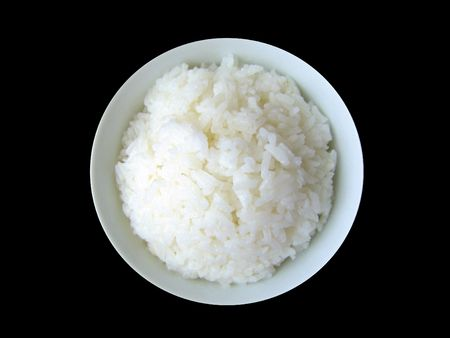 starch: A bowl of white rice with a lot of starch and carbohydrate