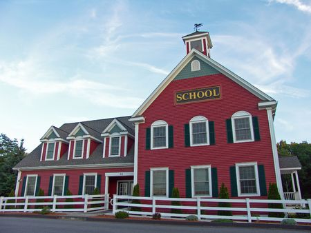 Colonial House School Building Against Blue Sky