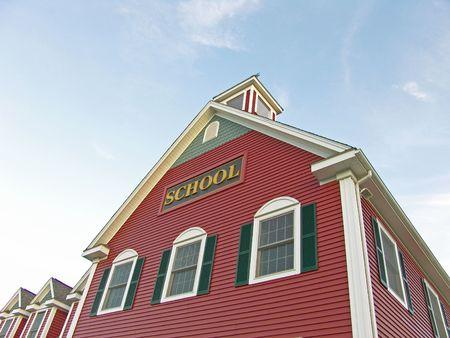 Colonial House School Building Against Blue Sky