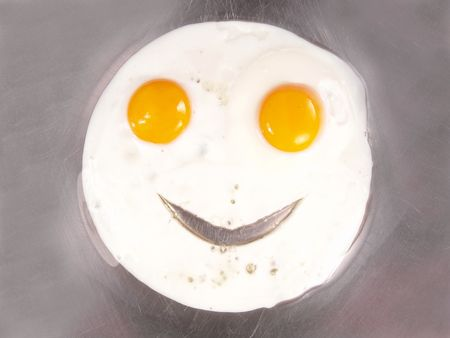 Happy Face Frying Eggs Sunny Side Up Close-up                                Standard-Bild