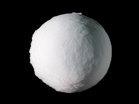 A perfectly round and large snowball ice globe isolated on black background