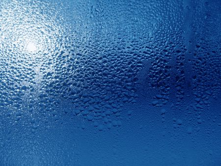 Close-up clear drops of water on window glass surface                                Stock Photo