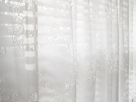 Abstract white lace blinds window pattern background                                Фото со стока
