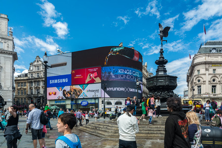 London, United Kingdom - July 11, 2016: Tourists visiting London, in front of Piccadilly Circus