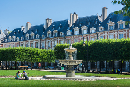 citytrip: Paris, France - August 13, 2016: The Place des Vosges, originally Place Royale, is the oldest planned square in Paris and one of the finest in the city.