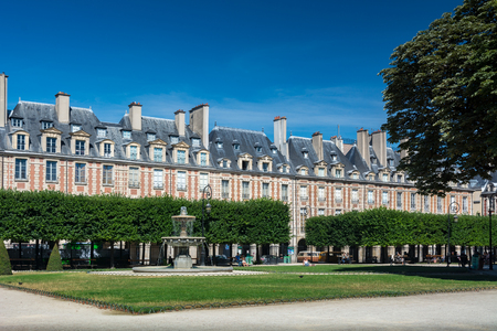 Paris, France - August 13, 2016: The Place des Vosges, originally Place Royale, is the oldest planned square in Paris and one of the finest in the city.