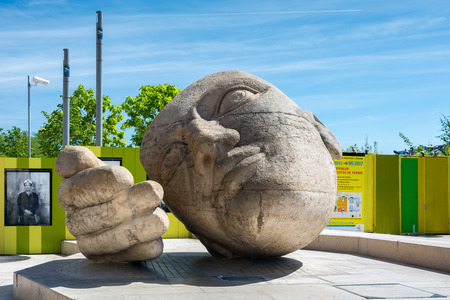citytrip: Paris, France - August 13, 2016: The sculpture named Lecoute by Henri de Miller is located near The Church of St Eustache