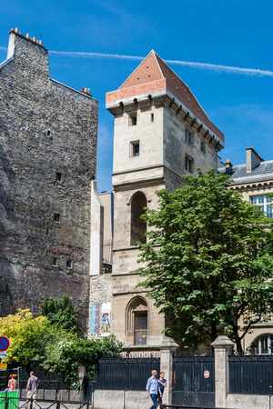 Paris, France - August 13, 2016: The Tour Jean sans Peur -- Tower of John the Fearless -- is the last vestige of the Hotel de Bourgogne, the residence first of the Counts of Artois and then the Dukes of Burgundy.
