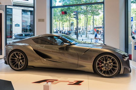citytrip: Paris, France - August 13, 2016: A protoype of the FT-1 by Toyota, seen on the Champs-Elysees in Paris.