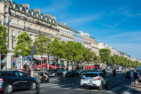 citytrip: Paris, France - August 13, 2016: The Avenue des Champs-Elysees is an avenue in the 8th arrondissement of Paris, 1.9 kilometres long, running between the Place de la Concorde and the Place Charles de Gaulle, where the Arc de Triomphe is located Editorial