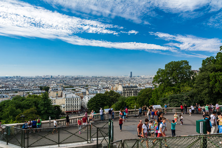 citytrip: Paris, France - August 14, 2016: Panorama of Paris from the top of the hill of Montmartre whith tourists visiting the city.