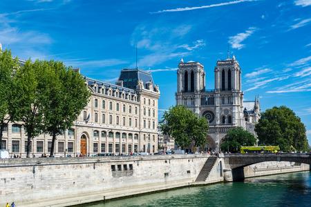 citytrip: Paris, France - August 13, 2016: The Cathedral Notre-dame de Paris and the river Seine. Notre-Dame is a medieval Catholic cathedral on the ile de la Cite in the fourth arrondissement of Paris, France.