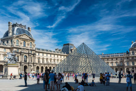 citytrip: Paris, France - August 13, 2016: The Louvre Museum is the worlds largest museum and a historic monument in Paris. A central landmark of the city, it is located on the Right Bank of the Seine in the citys 1st arrondissement