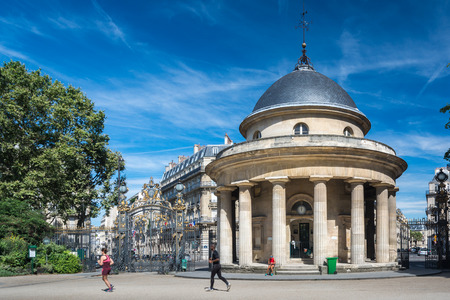 Paris, France - August 14, 2016: Parc Monceau is a public park situated in the 8th arrondissement of Paris. At the main entrance is a rotunda. The park covers an area of 8.2 hectares. Editorial