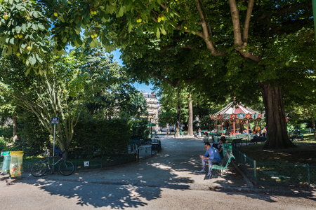 citytrip: Paris, France - August 14, 2016: Parc Monceau is a public park situated in the 8th arrondissement of Paris. At the main entrance is a rotunda. The park covers an area of 8.2 hectares. Editorial