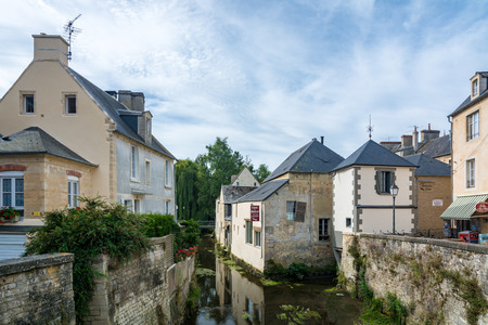 Bayeux, France - September 2, 2016: Scene of Bayeux with a waterway named the Aure. Editorial