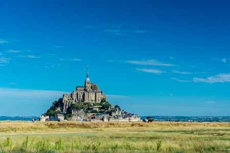 mount saint michael: Mont Saint-Michel, France - September 7, 2016: Saint Michaels Mount is an island commune in Normandy. The island has held strategic fortifications since ancient times and has been the seat of a monastery.