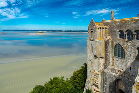 Mont Saint-Michel, France - September 7, 2016: The Mont Saint Michel Abbey and is an essential part of the structural composition of the town the feudal society constructed. The abbey has been protected as a French monument historique since 1862. Editorial