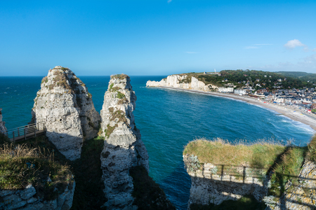 Etretat is best known for its chalk cliffs, including three natural arches and a pointed formation called LAiguille or the Needle, which rises 70 metres above the sea.