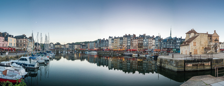 Honfleur, France - September 8, 2016: Honfleur is especially known for its old, beautiful picturesque port, characterized by its houses with slate-covered frontages, painted many times by artists