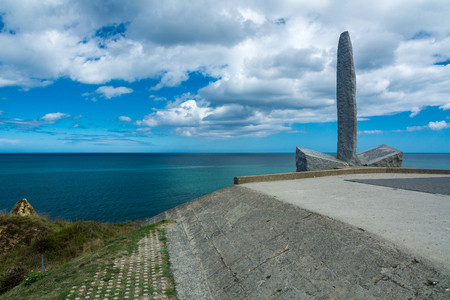hoc: Pointe du Hoc, France - September 9, 2016: During World War II, The Pointe du Hoc was the highest point between Utah Beach and Omaha Beach. On D-Day the US Army assaulted and captured Pointe du Hoc after scaling the cliffs. This is the memorial to the ran