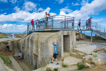 Pointe du Hoc, France - September 9, 2016: During World War II, The Pointe du Hoc was the highest point between Utah Beach and Omaha Beach. The German army fortified the area with concrete casemates and gun pits. On D-Day the US Army assaulted and capture