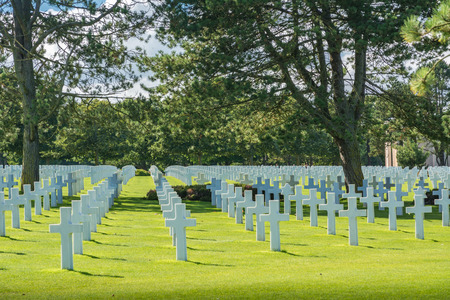 Colleville-sur-Mer, France - September 9, 2016: The Normandy American Cemetery and Memorial is a World War II cemetery and memorial that honors American troops who died in Europe during World War II. The US flag flies over these granted soils.