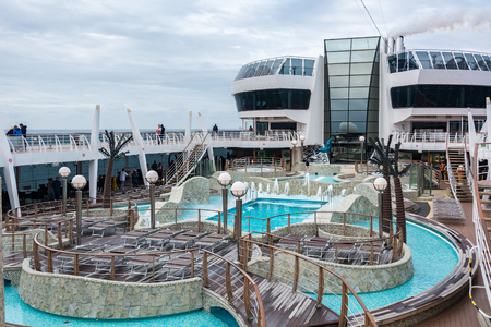 Hirtshals, Denmark - September 8, 2017: Swimming pool on the MSC Fantasia Banco de Imagens - 116199219