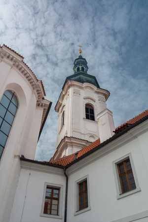 At its core, this abbey, situated in the middle of the Premonstratensian monastery at Strahov, is a Romanesque basilica with a Gothic transept and two Renaissance towers